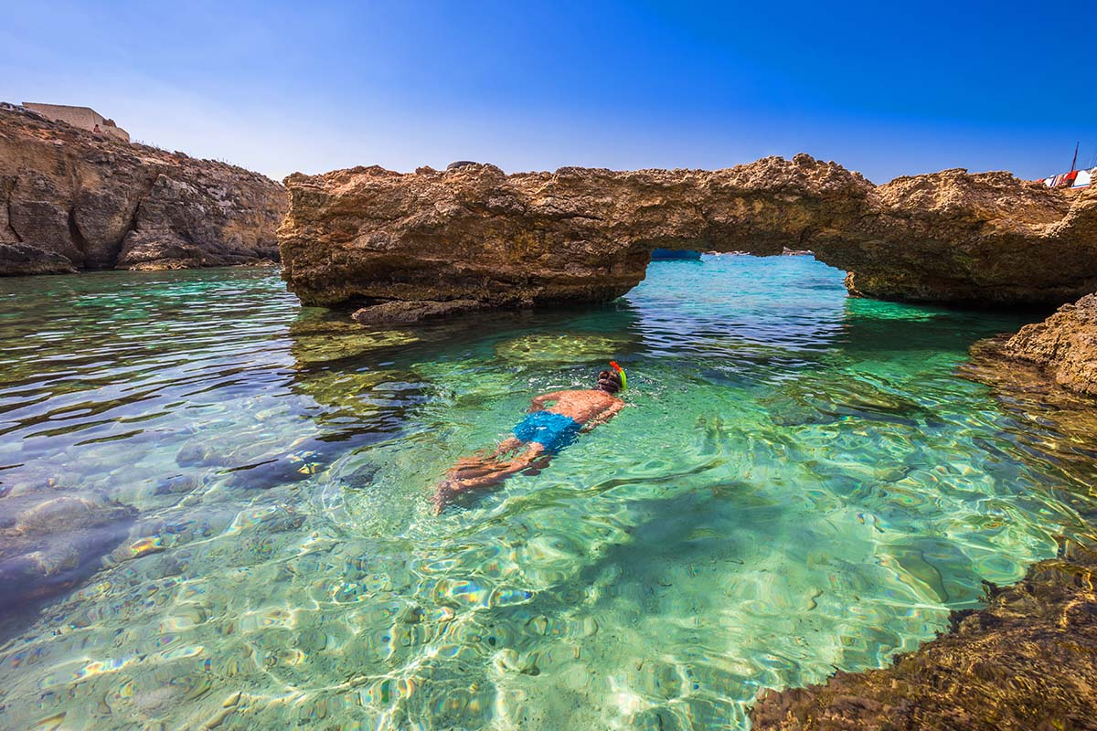 Best things to do in Malta? Snorkel in one of the pristine bays of Malta, Gozo, or Comino